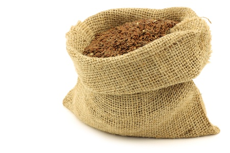 Flax seed  linseed  in a burlap bag on a white background Stock Photo - 15109728