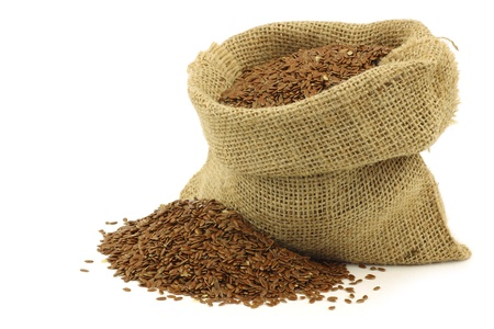 Flax seed  linseed  in a burlap bag on a white background