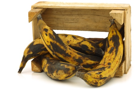 plantain: sweet ripe baking bananas  plantain bananas  in a wooden crate on a white background