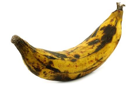 one ripe baking banana  plantain banana  on a white background Фото со стока