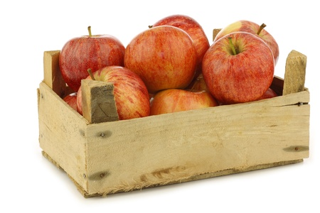 fresh  royal gala  apples in a wooden crate on a white background  Фото со стока