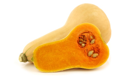 bottle shaped butternut pumpkin and a cut one on a white background