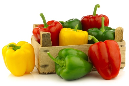 red,yellow and green bell peppers  capsicum  in a wooden crate on a white background Фото со стока - 15886604