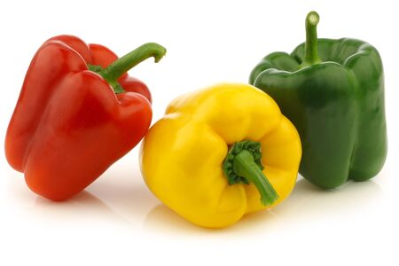 red,yellow and green bell peppers  capsicum  on a white background photo