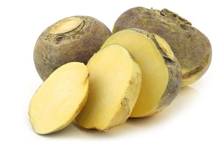 fresh turnip brassica rapa rapa  and a cut oneon a white background
