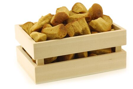 pepernoten: bunch of Dutch traditionally baked  pepernoten  eaten at Dutch festivities around december 5th called  Sinterklaas  in a wooden box on a white background Stock Photo