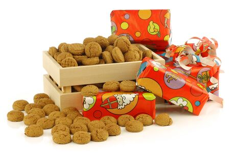 bunch of Dutch  pepernoten  eaten at Dutch festivities around december 5th called  Sinterklaas  in a wooden box on a white background Stock Photo - 16643365