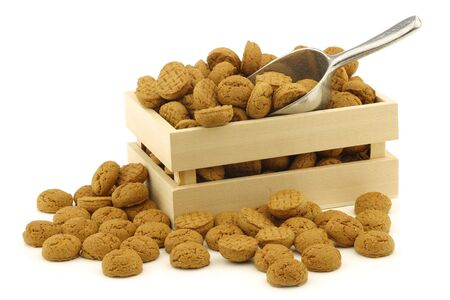 bunch of Dutch  pepernoten  eaten at Dutch festivities around december 5th called  Sinterklaas  in a wooden box on a white background Stock Photo - 16643364