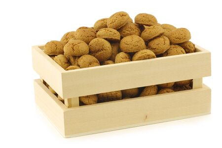 bunch of Dutch  pepernoten  eaten at Dutch festivities around december 5th called  Sinterklaas  in a wooden box on a white background Stock Photo - 16643363