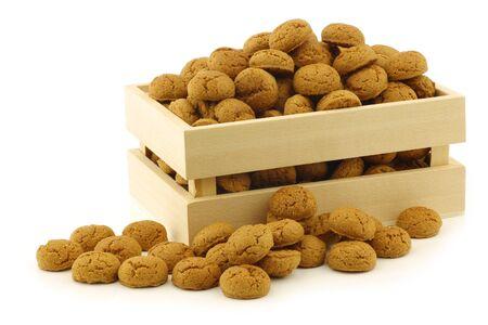 bunch of Dutch  pepernoten  eaten at Dutch festivities around december 5th called  Sinterklaas  in a wooden box on a white background Stock Photo - 16643362