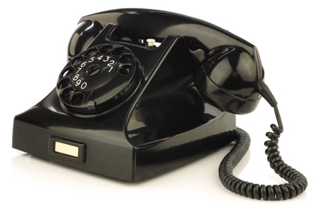 vintage bakelite telephone on a white background photo