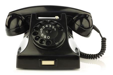 vintage bakelite telephone on a white background photo