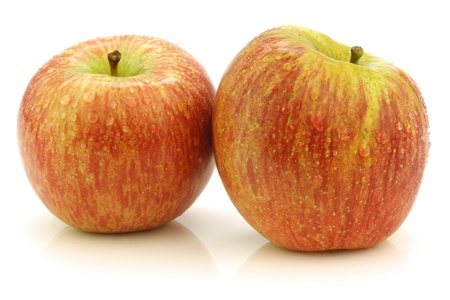 harvests: fresh  Fuji  apples on a white background
