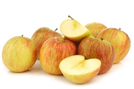 fresh  Fuji  apples and some pieces on a white background