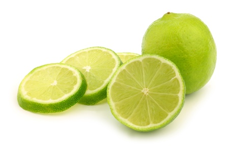 fresh lime fruit and some thin slices on a white background photo