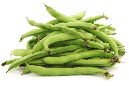 bunch of broad beans on a white background Stock Photo - 18940931