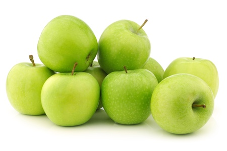 freshly harvested  Granny Smith  apples  on a white background