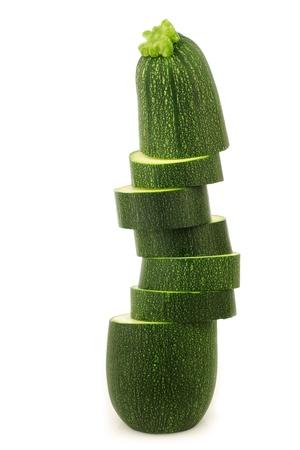 cucurbita: one cut zucchini  Cucurbita pepo  on a white background