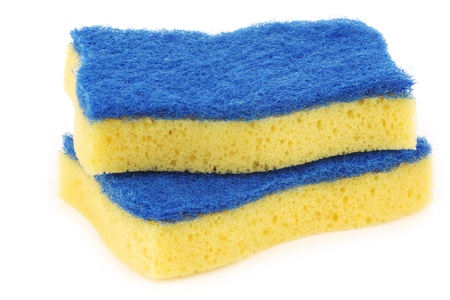 abrasive:  yellow and blue  abrasive pads on a white background