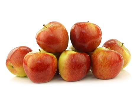 bunch of braeburn apples on a white background
