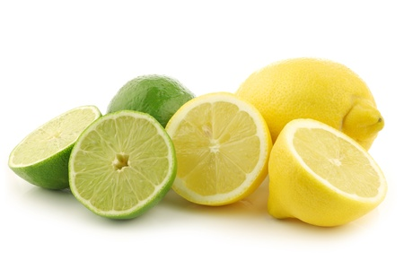 colorful fresh lime and lemon fruit and a cut one on a white background photo