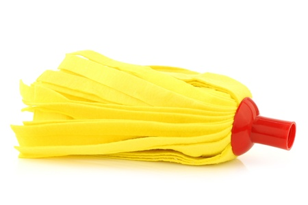 disinfecting: yellow cleaning mop isolated on white background