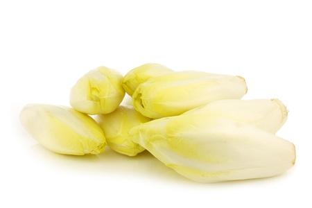 fresh chicory on a white background Фото со стока
