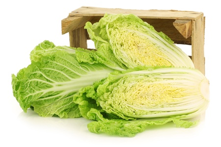 fresh chinese cabbage in a wooden crate on a white background 版權商用圖片