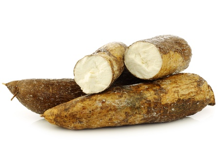 cassava root and some pieces on a white background