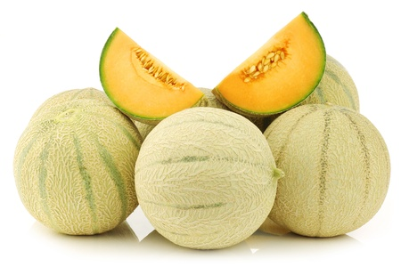 fresh cantaloupe melons and a cut one on a white background photo