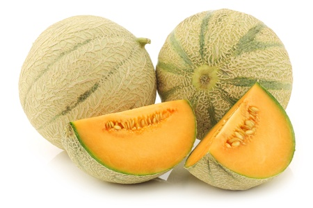 cantaloupe melons and a cut one on a white background photo