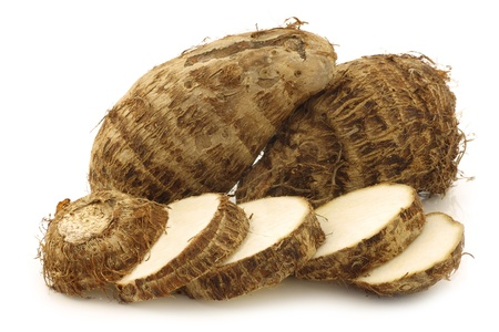 two fresh taro roots and a cut one  colocasia  on a white background Фото со стока - 20954871