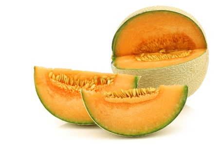 cut fresh cantaloupe melon on a white background photo