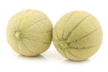 two whole cantaloupe melons on a white background photo
