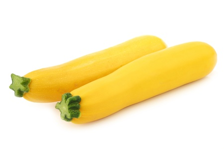 two yellow zucchini s on a white background