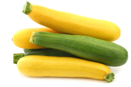 mixed yellow and green zucchini s on a white background