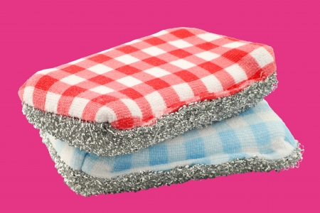 two red and blue checkered abrasive pads on a pink background Banco de Imagens