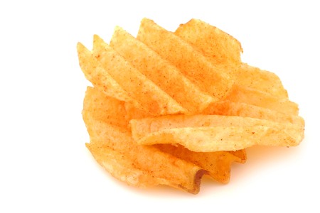 ridged: freshly baked deep ridged potato chips on a white background