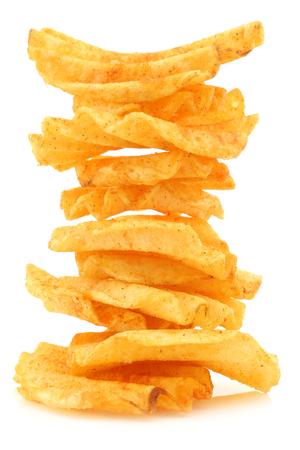 ridged: freshly baked stack of deep ridged potato chips on a white background