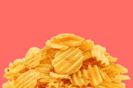 ridged: freshly baked deep ridged potato chips on a pink background