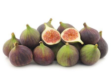 bunch of figs  Ficus carica  and a cut one on a white background photo