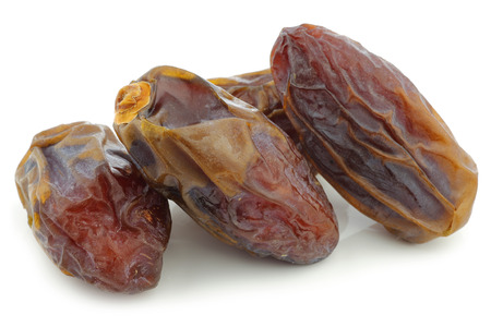 deglet: date fruit on a white background