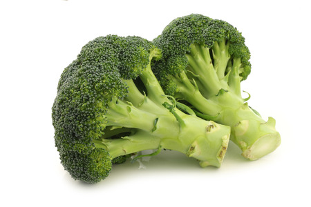 florets: Fresh broccoli florets on a white background Stock Photo