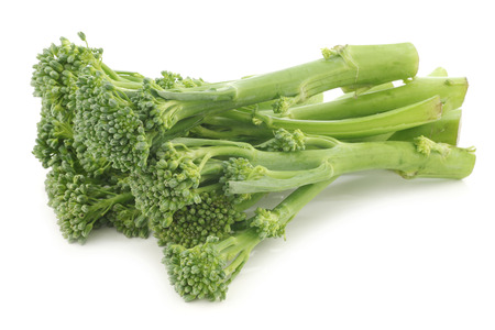 A small form of broccoli, called bimi, on a white background