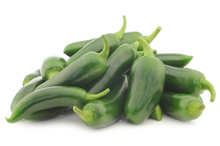 Bunch of fresh green peppers  capsicum  on a white background