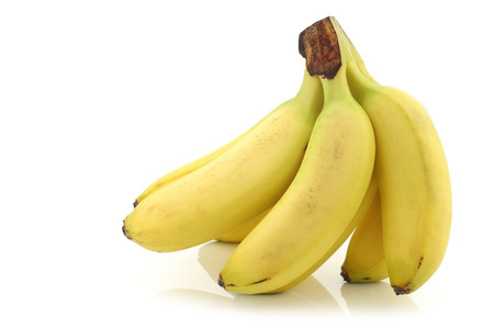 fresh bunch of mini bananas on a white background