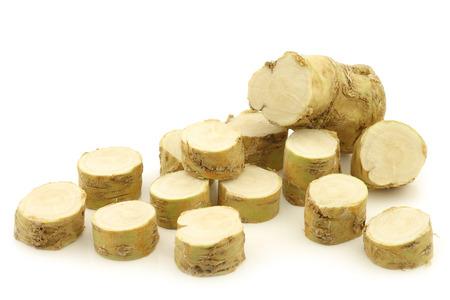 horseradish: freshly harvested cut horseradish pieces on a white background