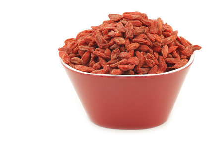 lycium: dried goji berries (Lycium Barbarum - Wolfberry) in a red bowl on white background