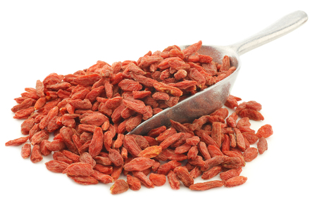 wolfberry: dried goji berries(Lycium Barbarum - Wolfberry) on an aluminum scoop on white background Stock Photo