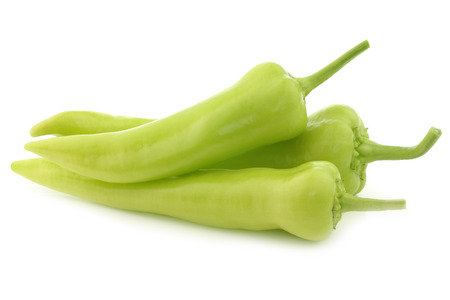 fresh green sweet peppers (banana peppers) on a white background